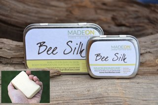 beesilk hard lotion bars in hand
