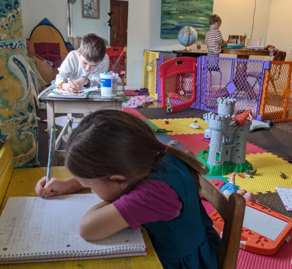 kids writing in notebooks