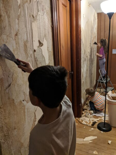 kids peeling wallpaper