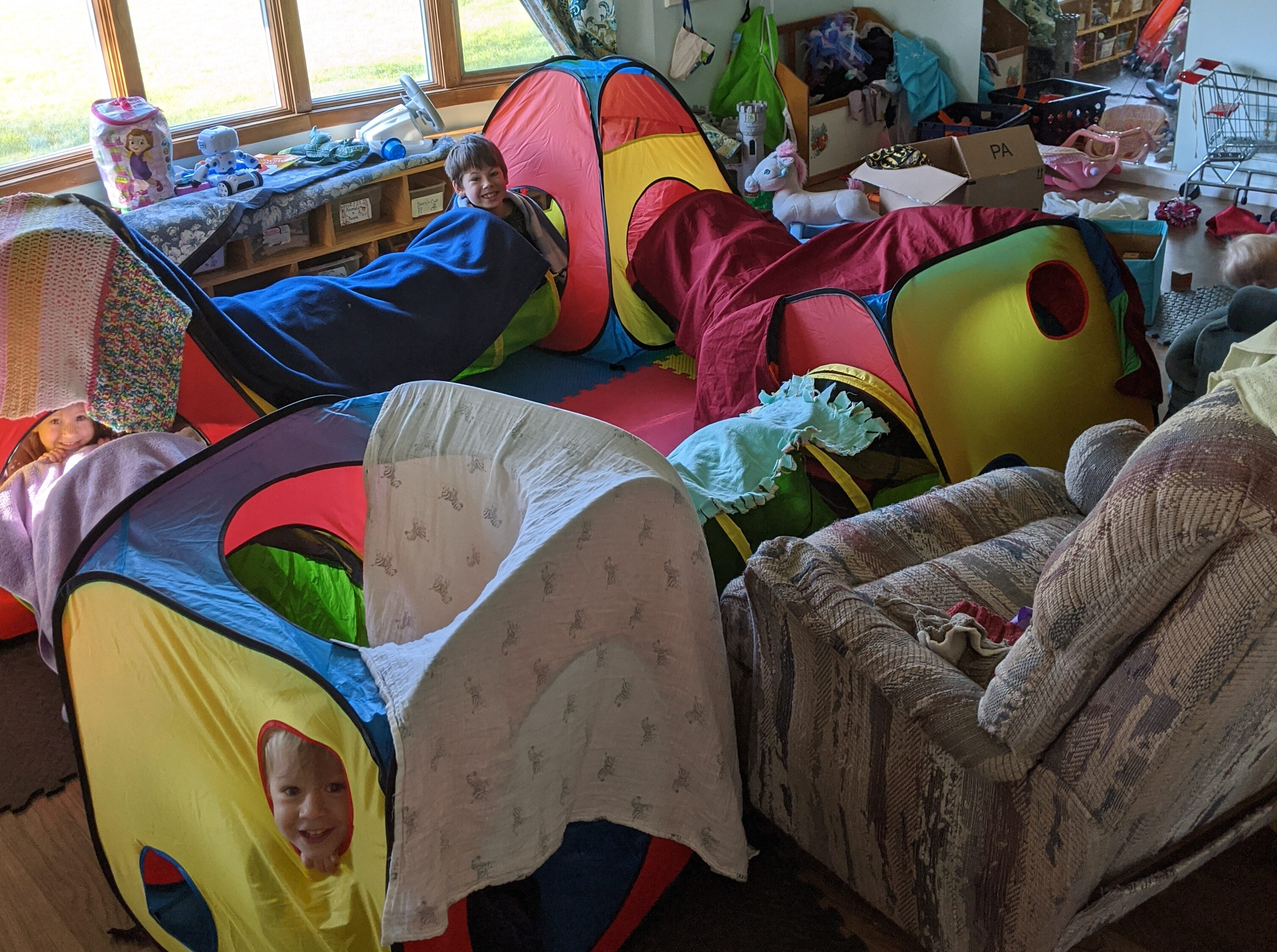 kids playing in toy tents