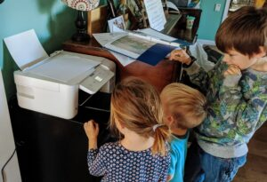 kids watching printer